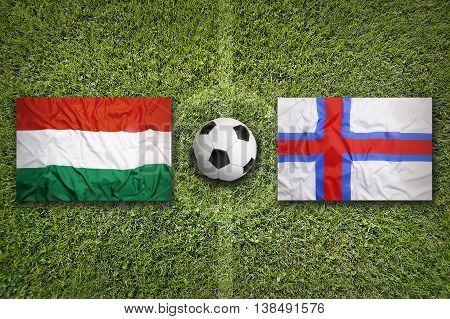 Hungary Vs. Faeroe Islands Flags On Soccer Field