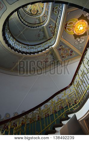 Riga, Latvia - July 06, 2012 - Vintage common staircase in an old high-rise building with nice ornate decoration. Modern style. 19th century.