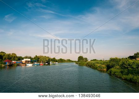 Calm river in evening light under thу sky