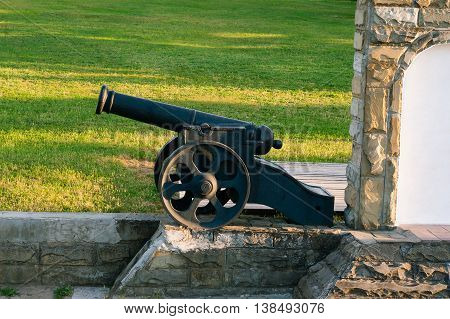 Old cannon set on the stone wall