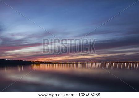Dramatic sunset over Volga River and Presidental Bridge, located in Ulyanovsk, Russia.