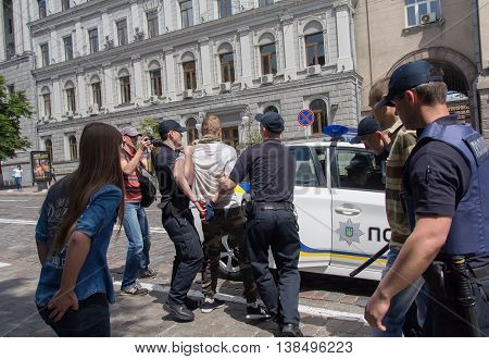Kiev Ukraine - June 12 2016: Police officers detain participants of the youth of the radical groups tried to prevent the holding of a gay parade