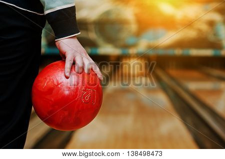 Bowling Ball At Hand Of Man Background Bowling Alley