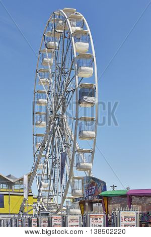 PORTSMOUTH UK JULY 2016: Ferris wheel on Portsmouth Seafront. (Solent Wheel) Portsmouth / South sea seafront.