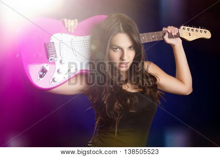 Rock star girl holding guitar