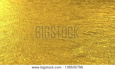 Defocused golden toned water surface background. Flecks of sunlight and ripples on the water. Water background. Water surface texture.