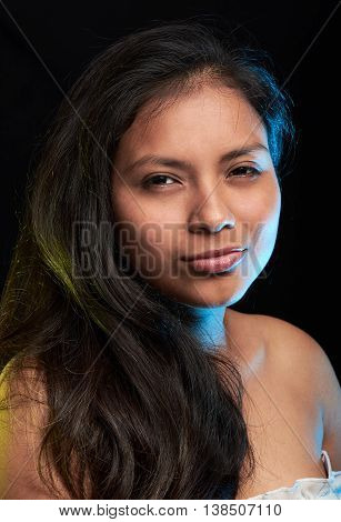 portrait of mean young latino girl on black poster