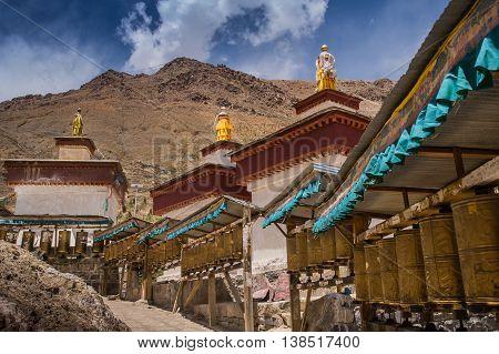 Kora Prayer wheels installed in Tibetan temple.