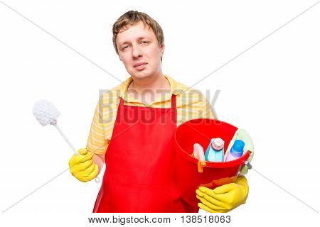 Smiling Man In An Apron Holding A Bucket With Cleaning Agents On A White Background