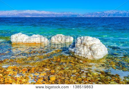 The Dead Sea is one of the tworld's saltiest bodies of water creating unusual stones' covers Ein Gedi Israel.