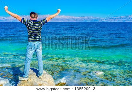 The happy man enjoy the beauty of the Dead Sea Ein Gedi Israel.