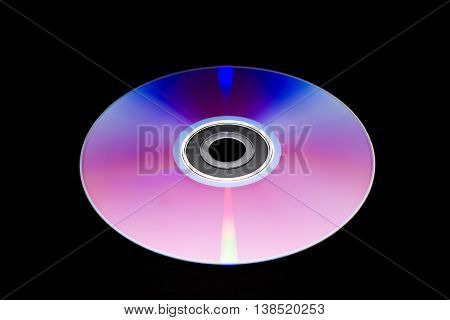 the one dvd in the center on black background