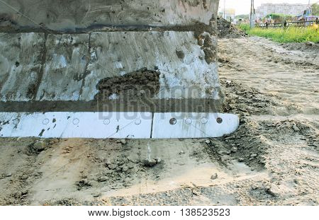 blade in the bulldozer and ground for construction work on the road