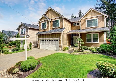 Nice Curb Appeal Of American Two Story House With Perfect Landscape Design.