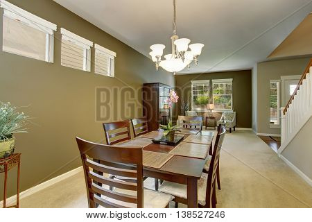 Dining Area With Deep Brown Table Set And Carpet Floor