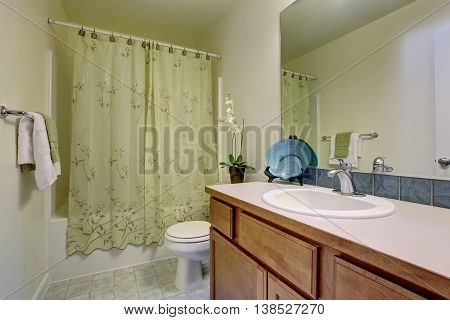 Bathroom interior with tile floor wooden cabinets big mirror and bath tub poster