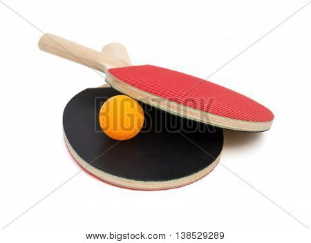 two pingpong rackets and a ball on white with clipping path