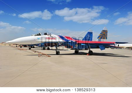 Sakhir Kingdom of Bahrain - Circa January 2012: One of four Sukhoi Su-27s jet fighters belonging to the Russian Knights aerobatic demonstration team of the Russian Air Force parked on the apron at the Sakhir Airbase Kingdom of Bahrain during the 2nd Bahra