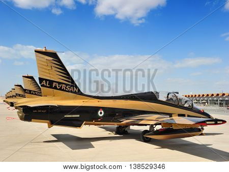 SAKHIR KINGDOM OF BAHRAIN - JANUARY 21: Aermacchi MB-339A jet trainer of the Al Fursan aerobatic team of the United Arab Emirates Air Force at the Sakhir Airbase during the 2nd Bahrain International Airshow 19-21 January 2012 in Bahrain