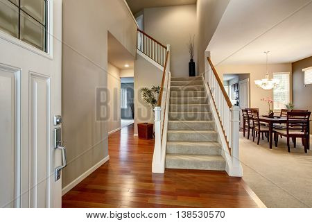 Light Entryway With View Of Staircase, Hallway And Dining Room.