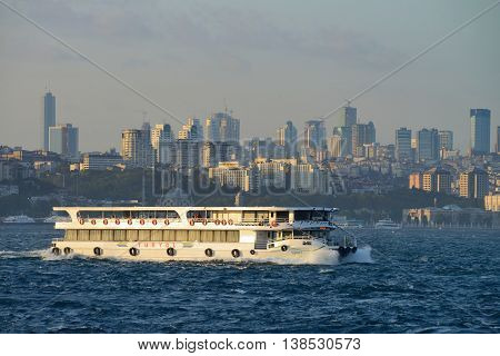 ISTANBUL - AUGUST 7: Cruise ship sails in Bosporus, August 7, 2013 in Istanbul, Turkey. Some 50,000 ships pass through the Turkish Straits every year.