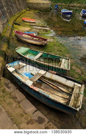 STAITHES ENGLAND - JULY 12: Old wooden rowing boats moored in Staithes Beck. In Staithes North Yorkshire England. On 12th July 2016.