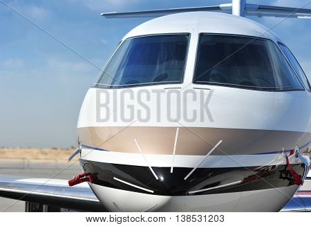 Closeup of an Executive Jet Cockpit against blue sky poster