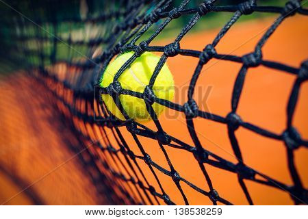 New Tennis ball in the tennis net