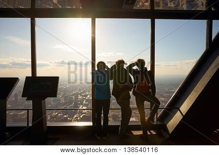 CHICAGO, IL - CIRCA MARCH, 2016: visitors at John Hancock Center's observatory. The John Hancock Center is a supertall skyscraper at 875 North Michigan Avenue, Chicago.