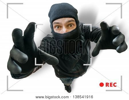 Masked Thief Or Robber Is Recorded With Security Hidden Camera.