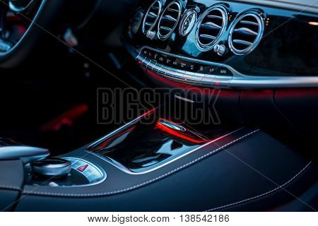 Luxury Car Interior Details. Middle Console With Air And Climate Controls