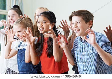 Group Of Children Enjoying Drama Club Together