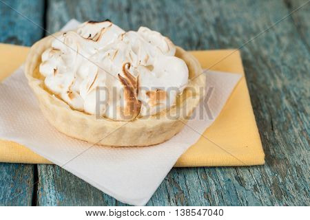 Lemon Tart With Meringue Air On Old Wooden Background