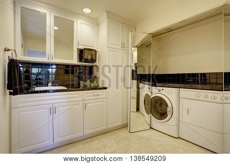 Small Kitchen Room With Built-in Laundry Area.