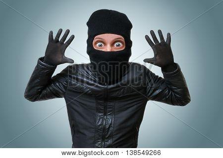 Funny Childlike Burglar Or Bandit Puts Hands Up.