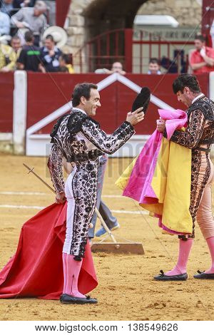Ubeda Spain - October 4 2011: The Spanish Bullfighter El Cid greeting the public with its cap in the hand in gratitude to its bullfight in the Bullring of Ubeda Spain