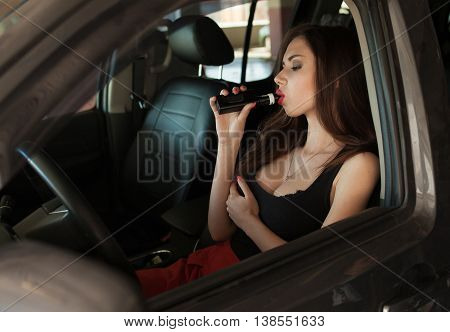 Sexy lady in car smoking ( vaping ) e-cigarette