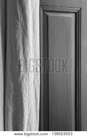 Interior detail with wooden window door and curtain. Indoor decoration. Vertical