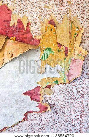 Old grunge tattered wallpaper in a ruined house