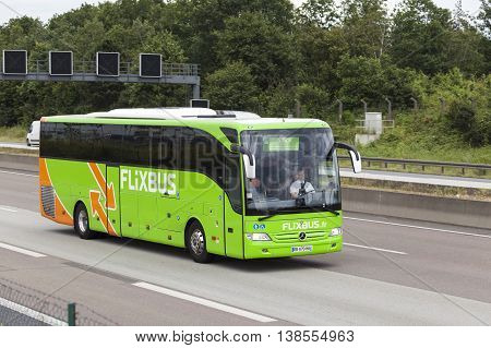 FRANKFURT GERMANY - JULY 12 2016: Green Flixbus european long distance coach on the highway in Germany