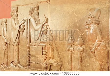 TEHRAN, IRAN - OCTOBER 6, 2014: Persepolis relief with historical scene and king Darius in National Museum on October 6, 2014. Established in 1937, museum contain artifacts from Achaemenid period.