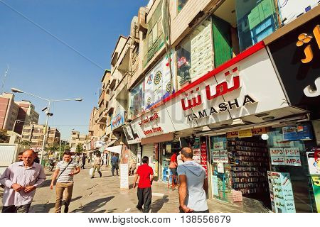 TEHRAN, IRAN - OCTOBER 6, 2014: Rushing customers walking past electronic stores on October 6 2014. About 30 perc. of Iran's public-sector workforce and 45 perc. of industrial firms are located in Tehran