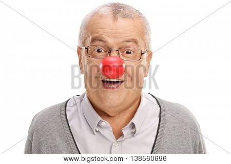 Joyful and funny mature man with a red clown nose isolated on white background