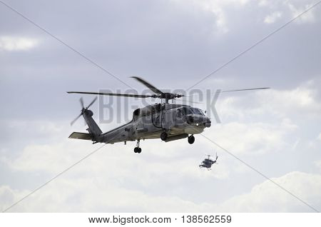Two formation black hawk helicopter rescue support team uh60 poster