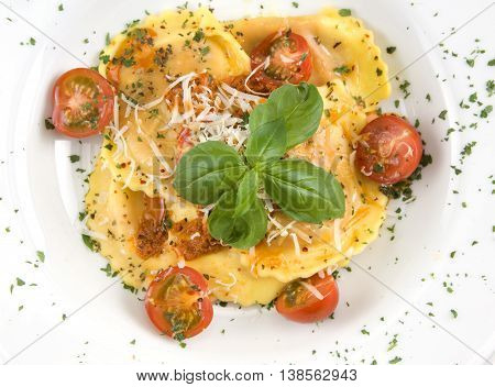 Ravioli with mozzarella cheese cherry tomatoes and basil