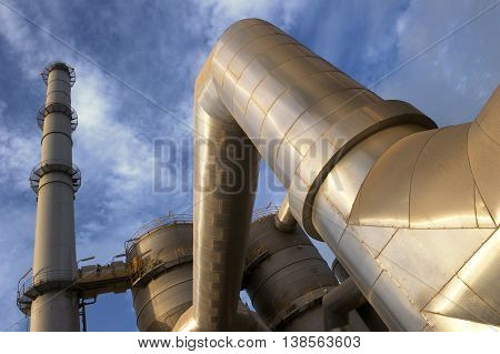 Industrial plant against blue sky and clouds