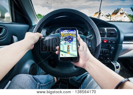 California, United States, 13 July 2016 : Pokémon Go is a free-to-play location based augmented reality mobile game developed by Niantic and published by The Pokémon Company as part of the Pokémon franchise.Hand holding a cellphone playing Pokemon Go game
