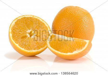 Fresh orange and orange slice isolated on white background