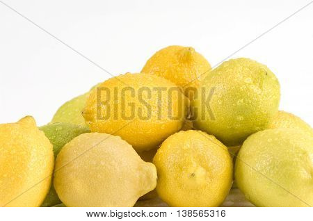 Pile of lemons on a white background