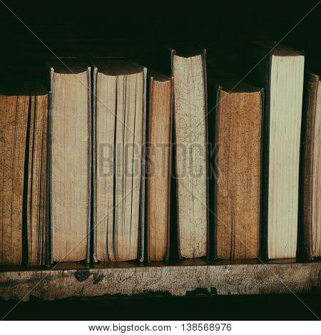 old books on wooden shelf. poster